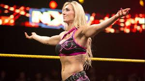 WWE Diva Goes Off On Fan Who Said Charlotte Looks Like A Dude.