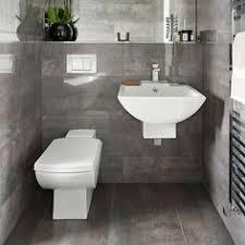 Image Plain Simple Dark Grey Tiled Bathroom Bathroom Decorating Housetohomecouk White Bathroom Tiles Pinterest 84 Best Grey Bathrooms Images Bathroom Bathroom Remodeling Home