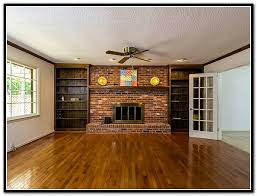 fireplace with bookshelves on either side