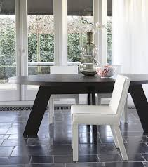 the ids dining table with crossed legs is inspired by the starting position of an sd skater ids is available in oval square round and rectangle