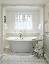 absolutely bathtub side table little luxury 30 bathroom that delight with a for the shelf on