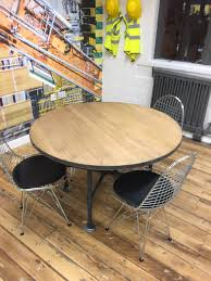 solid oak industrial style dining table round oak kitchen table industrial chic steel band edge with black coach detailing