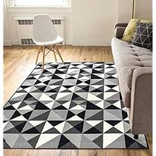 gray black geometric rug and white living room with decor of