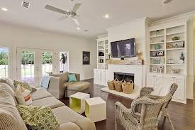 bookshelves next to fireplace living room beach style with custom home wicker chairs white brick fireplace
