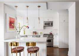 small white kitchen with mini brass and