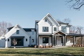 modern farmhouse with wrap around porch