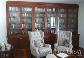 jarrah custom made built in bookcase with glass doors and cupboards