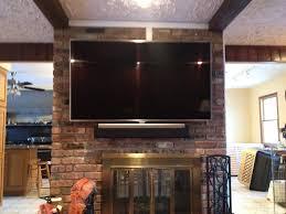 photo of one randolph nj united states tv mounted all brick fireplace
