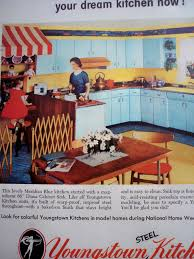 notice the kitchen cabinets and accent color yellow with red
