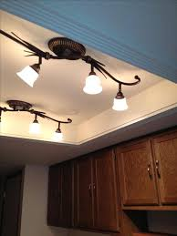 convert recessed light to track light convert that ugly recessed fluorescent ceiling lighting in your kitchen to a beautiful ceiling