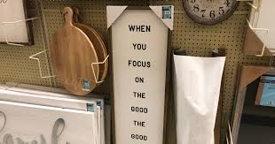 This mdf piece has a rectangular shape with a rich brown frame, white background, and three black circles with white letters in the center. Up To 65 Off Wall Decor At Hobby Lobby
