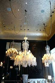 baccarat chandelier cost three grand chandeliers hang seemingly casually spaced suspended by rough cord rope chandeliers
