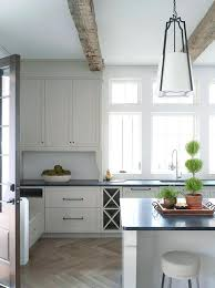 light gray wood floors off white kitchen cabinets with light gray wash herringbone wood floor light