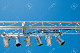 Blue Stage Lighting A Overhead Stage Lighting Rig Against A Clear Blue Sky
