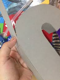 i cut a width of 1 5 inches of cardboard for the sides this would be the thickness of the letter next is to attach it in between the cut out js to