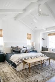 white slipcovered bed with gray overdyed rug