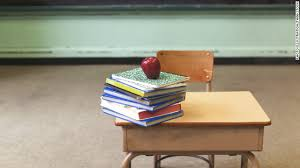 Image result for teacher and a desk