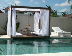 Romantic-Outdoor-Canopy-Bed-Furniture-Design-beside-pool - LaurieFlower