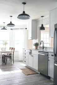 big floor tiles follow along the makeover of this beautiful farmhouse kitchen in this post shares