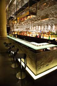 modern bar lighting. the sleek modern lights paired with natural stone of bar lighting