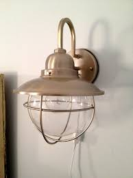 how to convert hard wired sconces to plug in