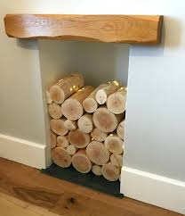 decorative logs for interior display make a statement stack them in an empty fireplace or alcove the log basket