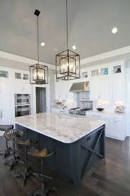 White And Navy Kitchen Features Iron Glass Cage Lanterns Over Center  Island Accented With Pinterest