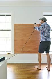 Cork boards for walls Black Using Power Drill To Screw Plywood Planks On Wall Between Two Windows To Become Base For Young House Love How To Make Giant Cork Board Wall For Kid Art Young House Love