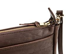 the kw buffalo leather purse is handmade from full grain leather this handcrafted purse has brass zippers is made in america and built to last