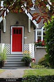 red front door white trim black accent stucco siding traditional home