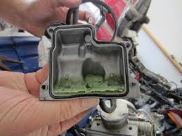 how to remove 1500 honda gl 1995 carburetor from engine • gl1500 this is the bottom of the float bowl of carburretor one the green substance is