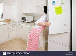 refrigerator in stock. stock photo - woman looking in refrigerator
