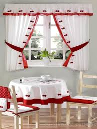 cherry kitchen curtain is embroidered delicately and is finished with a red voile trim free matching tie backs are also included in this range
