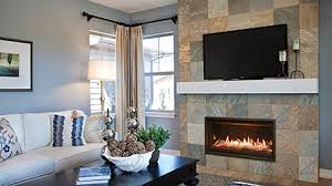 A sleek, modern fireplace and mantel, often with a TV placed above, is