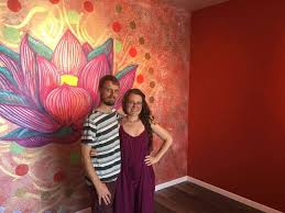 scott and kasie lunson stand in the sun room getting ready for the opening of their