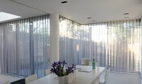 Our most challenging project to date: insetting of curtain tracks into a  ceiling and designing sheer curtains that disappear into cupboards when not  in use