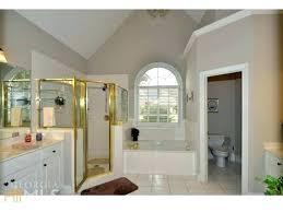bathroom with walk in closet bathroom with walk in closet master bedroom with bathroom and walk