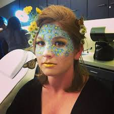 blue daisy inspired fantasy make up mask accented with yellow jewels and yellow lips by