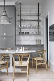 gray cabinets and white subway tile backsplash to ceiling