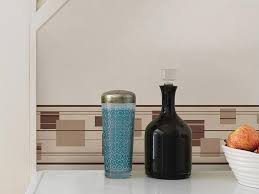 wallpaper border being used as a back splash above counter