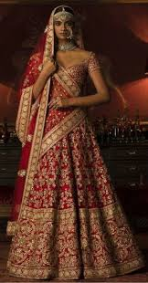 a bride can never go wrong with traditional shades of red and gold