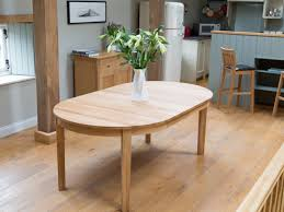 Solid Oak Round Extendable Dining Table Along With Four Dining Table