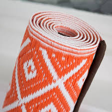 aztec outdoor rug in orange white