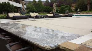 retractable pool cover. Custom Granite Counter Top Hides The Pool Cover System Retractable N
