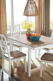 brovada dining room table and chairs set of 5 two tone