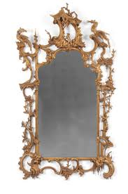 AN IMPORTANT ROCOCO GILTWOOD WALL MIRROR, CARVED WITH FABLE OF THE FOX AND  THE