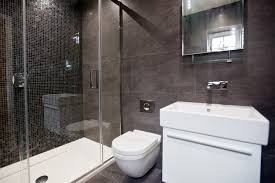 black ensuite with large floor and ceiling tiles and black mosaics from luxury bathroom with mosaics