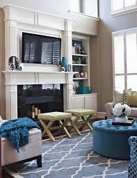 fireplace with tv tv above fireplace with bookshelves on each side family room