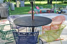 i love the multi colored chairs it s amazing how an old metal patio set