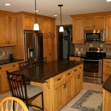 dark counters with wood cabinets kitchen countertop